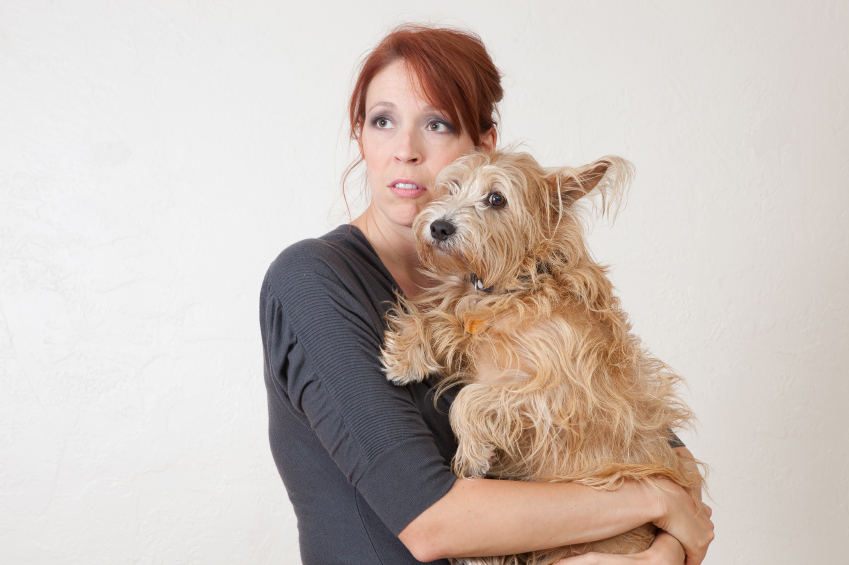 Anxious woman with dog iStock_000018303283_Small