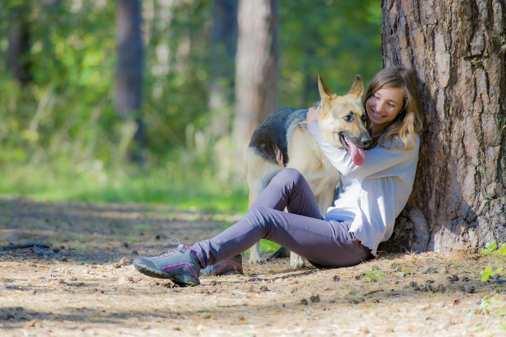 Women With Dog In Forest iStock_000030448978_Medium